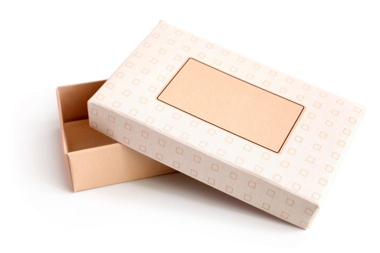 Open empty gift box on white background